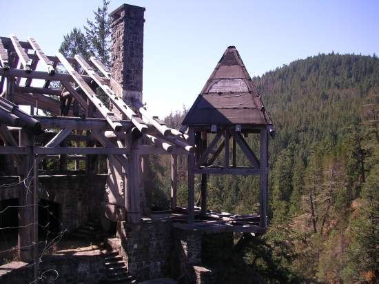 the skeleton of the lodge which stands uncompleted overlooking the Sooke River
